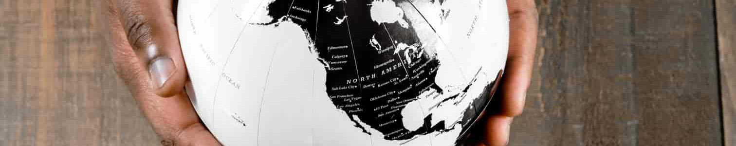 Hands holding a an earth globe map.